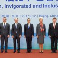 (L-R) OECD Secretary-General Angel Gurria, WTO Director-General Roberto Azevedo, WB President Jim Yong Kim, Chinese Premier Li Keqiang, IMF Chief Christine Lagarde, ILO Director-General Guy Ryder and G20's Chairman Mark Carney in Beijing's Diaoyutai State Guesthouse, on September 12.