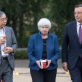 Bank of Japan Gov. Haruhiko Kuroda (L), Federal Reserve chief Janet Yellen (C) and ECB's Mario Draghi, walk the grounds at the Jackson Hole economic symposium in Moran, Wyoming in July.