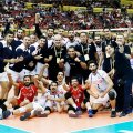 Iran players and coaching team celebrate after the victory