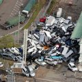 An aerial view shows vehicles piled in a heap due to strong winds in Kobe, Hyogo prefecture on September 5.