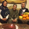 Marjaneh (L) and Manijeh Golchin (R) with their uncle Nader celebrating his 80th birthday.